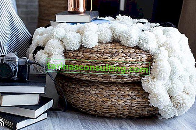 Come realizzare un tappeto in lana con pompon?